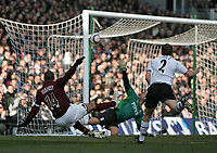 Photo: Lee Earle.<br /> Fulham v Arsenal. The Barclays Premiership. 04/03/2006. Arsenal's Thierry Henry (L) beats Fulham keeper Tony Warner to open the scoring.