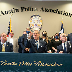 Austin, TX USA September 10, 2020: Texas Governor Greg Abbott , c,  alongside Republican Attorney General Ken Paxton , l,  and House Speaker Dennis Bonnen holds a press conference with Austin police and announced a plan to punish Texas cities that cut police spending. Abbott also asked state legislators and candidates for office to sign a pledge backing police with the hashtag #TexasBackstheBlue.