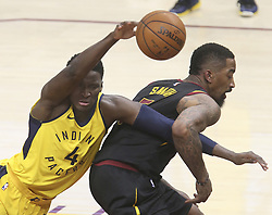 April 29, 2018 - Cleveland, OH, USA - Cleveland Cavaliers' J.R. Smith grabs the arm of Indiana Pacers' Victor Olidipo during the third quarter of Game 7 of the Eastern Conference First Round series on Sunday, April 29, 2018 at Quicken Loans Arena in Cleveland, Ohio. The Cavs won the game, 105-101. (Credit Image: © Phil Masturzo/TNS via ZUMA Wire)