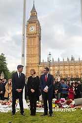 Parliament Square, Westminster, London, June 17th 2016. Following the murder of Jo Cox MP a vigil is held as friends and members of the public lay flowers, light candles and leave notes of condolence and love in Parliament Square, opposite the House of Commons. PICTURED: Ed Miliband, Harriet Harman and Wes Streeting