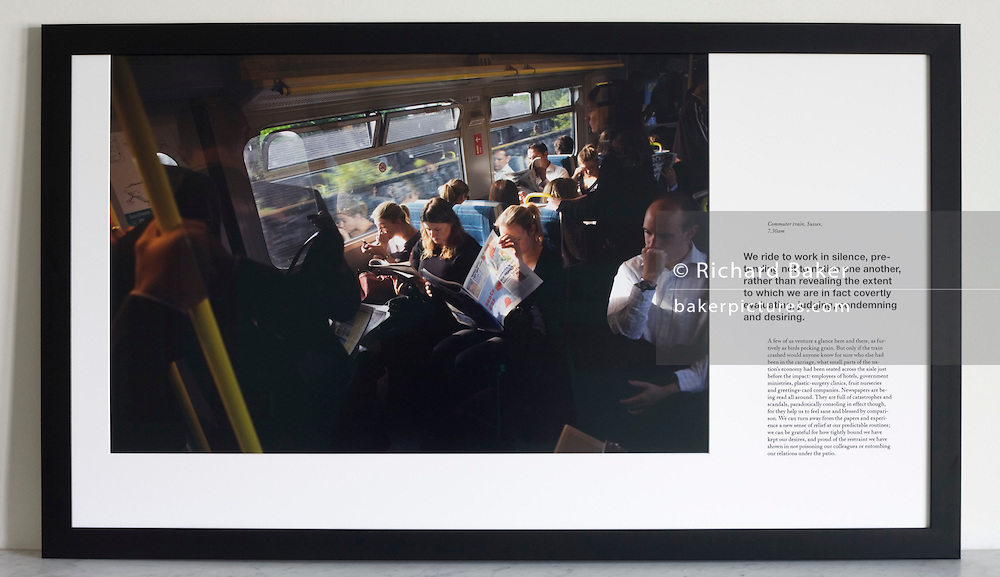 Rush hour train commuters on-board carriages traveling into central London. <br />