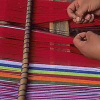 A woman weaves on a backstrap loom in Peru's Cordillera Vilcabamba.