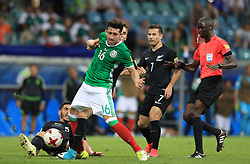 Mexico's Hector Herrera is fouled by New Zealand's Michael Boxall (left) resulting in a clash between the two sets of players