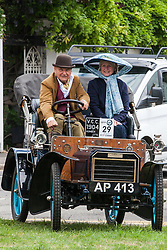 Datchet, UK. 30 June, 2019. A 1904 Humberette takes part in the 48-mile Ellis Journey from Micheldever station near Winchester to Datchet, a reenactment of the first recorded journey by a motorised carriage in England undertaken by pioneer automobilist Hon. Evelyn Ellis in his new, custom-built Panhard-Levassor on 5th July 1895. The original journey took place in contravention of the law because the Panhard exceeded a speed of 4mph and was not preceded by an attendant walking with a red flag.