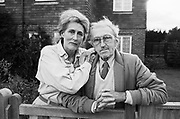 Two of the esteemed veteran photojournalists from the era of the weekly Picture Post magazine, Grace Robertson and Thurston Hopkins are is seen at the front gate of their home in East Sussex. Robertson was born in 1930 and Hopkins in 1913 and both worked under editor (Sir) Tom Hopkinson on the prominent photojournalistic magazine published in the United Kingdom from 1938 to 1957. It is considered a pioneering example of photojournalism and was an immediate success, selling 1,600,000 copies a week after only six months. It has been called the Life magazine of the United Kingdom.