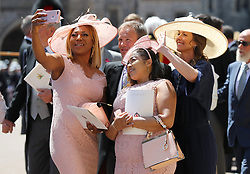 Weddding guests take a selfie outside St George's Chapel at Windsor Castle after the wedding of Meghan Markle and Prince Harry.