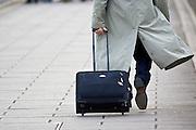 Commuter pulling a suitcase, London, England, United Kingdom