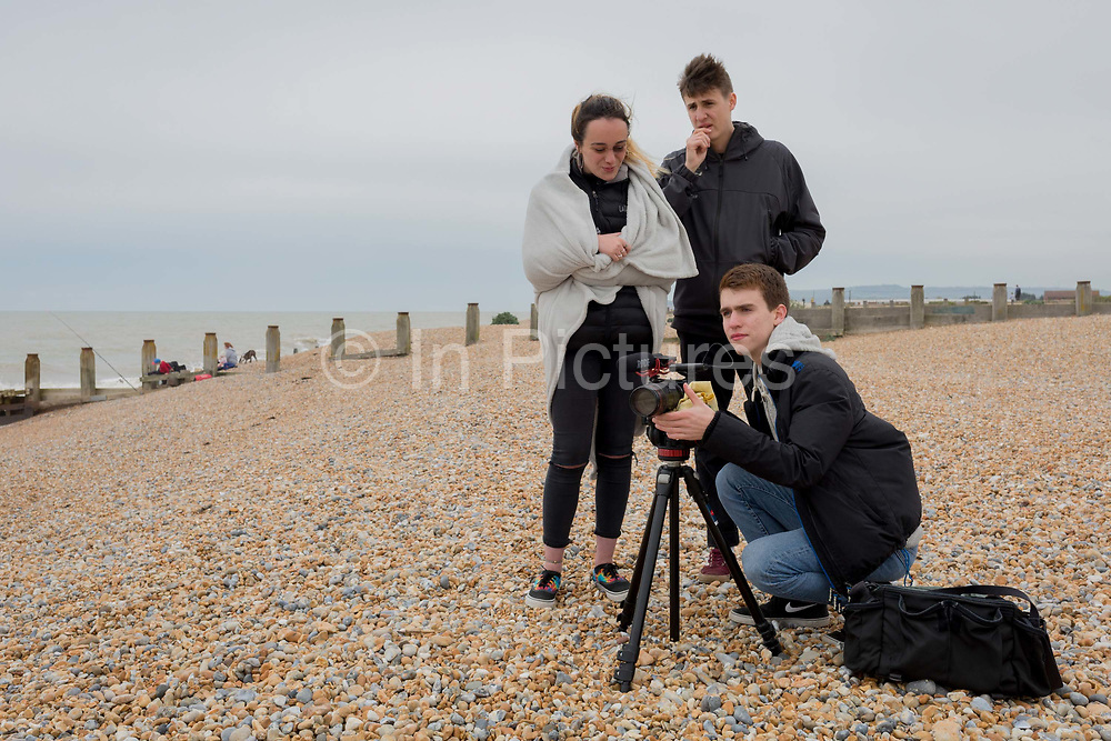 Teenage students from college in London learn the art of film production on location at the south coast, on 30th April 2017, at Winchelsea, England.