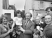 Taoiseach's Election Campaign.      (N77)..1981..23.05.1981..05.23.1981..23rd May 1981..On the 21st May the Taoiseach, Mr Charles Haughey, dissolved the Dáil and called a general election. Charles Haughey, Garret Fitzgerald and Frank Cluskey were leading their respective parties into a general election for the first time as they had only taken party leadership during the last Dáil..Fianna Fáil had hoped to call the election earlier, but the Stardust Tragedy caused the decision to be deferred...Image of Charles Haughey, Eileen Lemass and Liam Lawler on the campaign trail with supporters in Lucan.The child is Grainne Woods of Lucan.