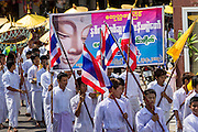 24 MAY 2013 - MAE SOT, THAILAND:  Members of the Burmese emigre community in Mae Sot, Thailand, participate in a procession for Visakha Puja Day. Visakha Puja (Vesak) marks three important events in the Buddha's life: his birth, his attainment of enlightenment and his death. It is celebrated on the full moon of the sixth lunar month, usually in May on the Gregorian calendar. This year it is on May 24 in Thailand and Myanmar. It is celebrated throughout the Buddhist world and is considered one of the holiest Buddhist holidays. Burmese Buddhist in Mae Sot celebrated with a procession through Mae Sot that ended with a service followed by a communal meal at Wat Pha Mai, the most important Burmese Buddhist temple in Mae Sot.   PHOTO BY JACK KURTZ