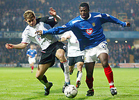Photograph: Scott Heavey.<br />Fulham v Portsmouth. FA Barclaycard Premiership. 24/11/2003.<br />Yakubu Ayegbini slips past Moritz Volz (L)