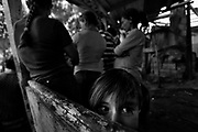 """Gypsies waiting for the pastor´s pray.<br /> The gipsies call it """"the Cult"""", it is a kind of pact that they get together twice a week in a common hut to pray for good and exorcise the evil. Inside the hut there´s a heavy atmosphere and things seem to be a blend of fantasy and reality. Tens of gipsies form a circle of screams and cries and you can hear a mix of prays, complains, desperation and guilt. A gipsie women faints on the floor almost like she has been exorcised and she had a demon inside her, slowly with the help of the others she recovers.<br /> The truth is that the cult is a way that gipsies chose to express themselves, something that is very much theirs, just like the sound of the gipsies guitars, shows something very real, the suffering of their spirits."""