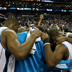 April 24, 2011; New Orleans, LA, USA; New Orleans Hornets players huddle up following a win over the Los Angeles Lakers during the fourth quarter in game four of the first round of the 2011 NBA playoffs at the New Orleans Arena. The Hornets defeated the Lakers 93-88.   Mandatory Credit: Derick E. Hingle