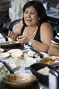 Diners eating lunch at Dr. Shakshouka, a kosher Tripolitanian restaurant in Jaffa, Tel Aviv, Israel