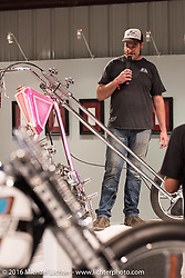 Eric Allard talks about his Glam Fairy Ironhead Sportster at the media meet and greet on the Industry party night for Michael Lichter's tattoo themed Skin & Bones Motorcycles as Art exhibition at the Buffalo Chip during the annual Sturgis Black Hills Motorcycle Rally.  SD, USA.  August 7, 2016.  Photography ©2016 Michael Lichter.