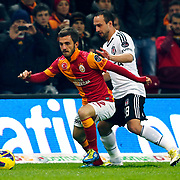 Galatasaray's Emre Colak (L) and Besiktas's  Mehmet Akgun (R) during their Turkish superleague soccer derby match Galatasaray between Besiktas at the TT Arena at Seyrantepe in Istanbul Turkey on Sunday, 27 January 2013. Photo by Aykut AKICI/TURKPIX