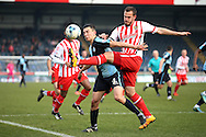 Luke Wilkinson of Stevenage ® challenges Luke O'Nien of Wycombe Wanderers. Skybet football league two match, Wycombe Wanderers  v Stevenage Town at Adams Park  in High Wycombe, Buckinghamshire on Saturday 12th March 2016.<br /> pic by John Patrick Fletcher, Andrew Orchard sports photography.