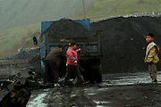 Wangjiazhai is a coal mining village in South West China.  Many of its inhabitants work with coal from digging, transporting and removal.  Surface mining from an open cast mining covers large areas of the village...