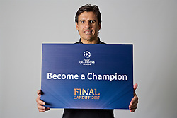 "CARDIFF, WALES - Friday, November 11, 2016: Wales' manager Chris Coleman holds up a board ""Become a Champion"" to encourage people to become volunteers for the 2017 UEFA Champions League Final in Cardiff. (Pic by David Rawcliffe/Propaganda)"