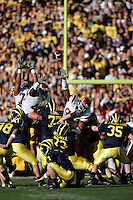 1 January 2007: Trojans try to block a kick  at the 93rd Rose Bowl Game at the Rose Bowl Stadium for the Pac-10 USC Trojans vs the Big-10 Michigan Wolverines NCAA college football game in Southern California.<br />