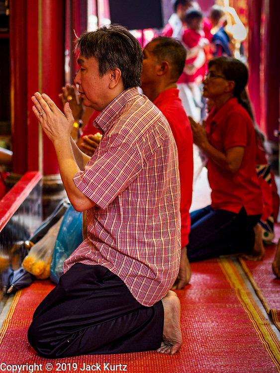 05 FEBRUARY 2019 - BANGKOK, THAILAND: A man prays on Chinese New Year at Wat Mangon Kamalawat, a large Chinese Buddhist temple in Bangkok's Chinatown. Chinese New Year celebrations in Bangkok started on February 4, 2019, although the city's official celebration is February 5 - 6. The coming year will be the Year of the Pig in the Chinese zodiac. About 14% of Thais are of Chinese ancestry and Lunar New Year, also called Chinese New Year or Tet is widely celebrated in Chinese communities in Thailand.      PHOTO BY JACK KURTZ
