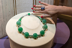 """© Licensed to London News Pictures. 29/06/2017. London, UK.  A staff member presents an """"Imperial Jade Beads"""" necklace, the largest jade beads necklace known to date.  Members of the public visit Masterpiece London, a leading art fair held in the grounds of the Royal Hospital Chelsea.  The fair brings together 150 international exhibitors presenting works from antiquity to the present day and runs 29 June to 5 July 2017.  Photo credit : Stephen Chung/LNP"""