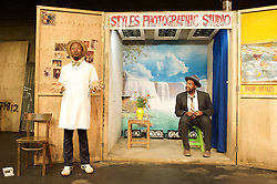 Sizwe Banzi is Dead <br /> directed by Matthew Xia<br /> designed by Hyemi Shin <br /> at The Young Vic Theatre, London, Great Britain <br /> press photocall<br /> 12th February 2014 <br /> <br /> <br /> Sibusiso Mamba as Sizwe Banzi <br /> <br /> Tonderai Munyevu as Styles / Buntu <br /> <br /> Photograph by Elliott Franks