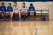 The Durant Middle School 7th grade boys basketball team looks on during a game in Durant, Oklahoma on January 27, 2017.  (Cooper Neill for The New York Times)