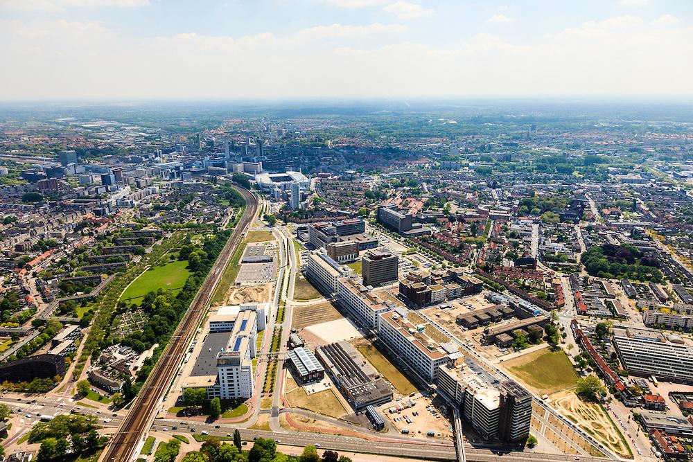 Nederland, Noord-Brabant, Eindhoven, 27-05-2013; Strijp-S, voormalige Philipsterrein, was niet toegankelijk voor het publiek, 'de verboden stad'. Het gebied, met diverse Rijksmonumenten, wordt ontwikkeld voor wonen, werken en cultuur.<br /> Links Philitefabriek met Klokgebouw (Strijp S), in het midden het Veemgebouw met daar direct naast De Hoge (Witte) Rug. Rechts in baksteen het voormalige NatLab. <br /> <br /> Strijp-S, former Philips area, was not accessible to the public, 'the forbidden city'. The area, with several national monuments, is designated for living, working and culture.<br /> Left Philitefabriek / Clock Building (Strijp S), in the middle of the Veemgebouw next to the High (White) Back.  Right in the former NatLab (brick building). <br /> <br /> luchtfoto (toeslag op standard tarieven);<br /> aerial photo (additional fee required);<br /> copyright foto/photo Siebe Swart