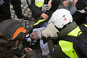December, 8th, 2018 - Paris, Ile-de-France, France: Demonstrator wounded by riot police projectile during protest on Champs Elysees. The French 'Gilets Jaunes' demonstrate a fourth day. Their movement was born against French President Macron's high fuel increases. They have been joined en mass by students and trade unionists unhappy with Macron's policies. Nigel Dickinson