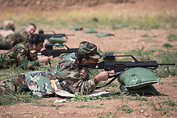 © Licensed to London News Pictures. 30/03/2015. Erbil, Iraq. A Kurdish peshmerga officers practice aiming their G36 assault rifles, donated by Germany, during a training package run by coalition forces at a military training area near Erbil, Iraq.<br /> <br /> 8,000 G36 and 8,000 G3 assault rifles were donated by the German government to the peshmerga, along with 6 million pieces of ammunition for the weapons.<br /> <br /> The training is part of a four week long package, the first to be held with a complete peshmerga battalion, run by coalition forces mobile training teams (MTT) in Kurdistan with the aim to make the peshmerga more efficient in combatting the Islamic State. Photo credit: Matt Cetti-Roberts/LNP