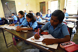 September 7, 2017 - Allahabad, Uttar Pradesh, India - Allahabad: Students attend a class at a government primary school on the eve of International Literacy Day in Allahabad. September 8 was declared International Literacy Day by UNESCO on November 17, 1965. Its aim is to highlight the importance of literacy to individuals, communities and societies. Celebrations take place in several countries (Credit Image: © Prabhat Kumar Verma via ZUMA Wire)