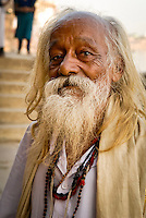 An old holy man on the ghats in Varanasi, Uttar Pradesh, India