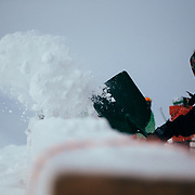 A JHMR employee shovels snow off of the deck of Corbet's Cabin at JHMR.
