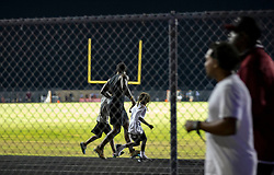 August 18, 2018 - Wellington, Florida, U.S. - Fans run for cover after shots were fired during the fourth quarter of a football game at Palm Beach Central High School. Two adults were shot Friday night at a football game between Palm Beach Central and William T. Dwyer high schools, authorities said. The gunfire sent players and fans screaming and stampeding in panic during the fourth quarter of the game at Palm Beach Central High School in Wellington, Florida on August 17, 2018. (Credit Image: © Allen Eyestone/The Palm Beach Post via ZUMA Wire)