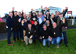 Members of the Lions Mouth Racing Club after Kalanisi OG and Billy Gleeson win the Galway Golf Club Flat Race during day two of the October Festival at Galway Racecourse.