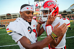 Sep 4, 2021; College Park, Maryland, USA; Maryland Terrapins quarterback Taulia Tagovailoa (3) celebrates with Maryland Terrapins quarterback Ryan Duell (12) after defeating the West Virginia Mountaineers at Capital One Field at Maryland Stadium. Mandatory Credit: Ben Queen-USA TODAY Sports