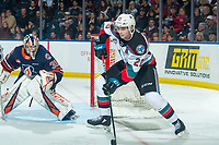 KELOWNA, BC - DECEMBER 27:  Dylan Garand #31 of the Kamloops Blazers keeps his eye on the puck and defends the net as Matthew Wedman #20 of the Kelowna Rockets skates from behind the net with the puck during third peirod at Prospera Place on December 27, 2019 in Kelowna, Canada. Wedman was selected in the 2019 NHL entry draft by the Florida Panthers. (Photo by Marissa Baecker/Shoot the Breeze)