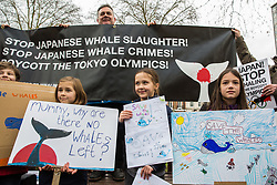London, UK. 26th January, 2019. Animal rights campaigner Dominic Dyer and children prepare to take part in the Japan: No Whaling march from Cavendish Square to the Japanese embassy following Japan's announcement that it withdraw from the International Whaling Commission (IWC) and resume commercial whaling with effect from July 2019. The march was organised by the London Committee for the Abolition of Whaling.