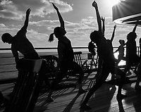 Afternoon yoga in the sun on the aft deck of the MV World Odyssey Image taken with a Leica T camera and 11-23 mm lens (ISO 100, 23 mm, f/14, 1/500 sec). Raw image processed with Capture One Pro including conversion to B&W.