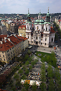 View of the Church of St Nicholas in the Old Town Square in the heart of Prague, Czech Republic. The square is surrounded by buildings tracing the history of Prague from Gothic, the Renaissance to Baroque.