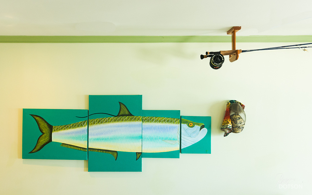 Neat painting in the room of El Pescador with 8-10wt rods ready for the next day of fishing.