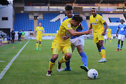 AFC Wimbledon midfielder Chris Whelpdale (11) and Peterborough United defender Andrew Hughes (3) tussles during the EFL Cup match between Peterborough United and AFC Wimbledon at ABAX Stadium, Peterborough, England on 9 August 2016. Photo by Stuart Butcher.