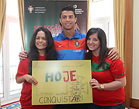 Fotball<br /> Portugal<br /> 02.06.2011<br /> Foto: CityFiles/Digitalsport<br /> NORWAY ONLY<br /> <br /> Portuguese National Football Team captain Cristiano Ronaldo signs autographs to two young ladies. The two fans won a facebook contest and had the chance to meet the portuguese star.