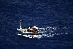 INDIAN OCEAN 24MAR13 - An unidentified Sri Lankan fishing vessel (IMUL-A-0374 KLT)  runs at full speed in the Chagos EEZ in the Indian Ocean.<br /> <br /> <br /> <br /> The Greenpeace ship Esperanza is on patrol in the Indian ocean documenting illegal fishing vessels.<br /> <br /> <br /> <br /> jre/Photo by Jiri Rezac / Greenpeace
