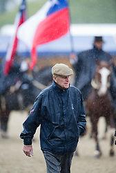 © London News Pictures. 10/05/2012. London, UK. HRH The Duke of Edinburgh battles through heavy rain after presenting awards in the Driving for the Disabled class at the Royal Windsor Horse Show in Windsor, Berkshire , on May 10, 2012. Photo credit: Ben Cawthra/LNP