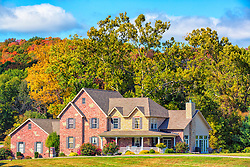 Fall colors frame this lovely large home