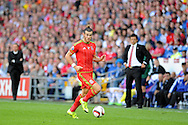 Gareth Bale of Wales in action as his Wales manager Chris Coleman looks on.. Euro 2016 qualifying match, Wales v Israel at the Cardiff city stadium in Cardiff, South Wales on Sunday 6th Sept 2015.  pic by Andrew Orchard, Andrew Orchard sports photography.