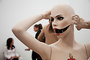 Open mouthed mannequin artwork. Visitors and exhibitors at the many galleries exhibiting at the Frieze Art Fair 2010. This art fair is for work at the high end of international contemporary art with many well known artists on show from many of the world's most reknowned dealers.