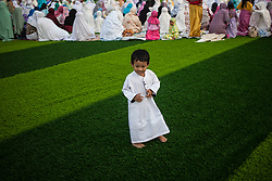 February 14, 2013 - Central Jakarta, Jakarta, Indonesia - A little boy during Eid Al-Fitr prayer on plastic grass at futsal stadium on June 15, 2018 in Jakarta, Indonesia. Muslims around the world are celebrating Eid al-Fitr, the three day festival marking the end of the Muslim holy month of Ramadan, it will be observed on 15th or 16th of June depending on the lunar calendar. Eid al-Fitr is one of the two major holidays in Islam. (Credit Image: © Afriadi Hikmal via ZUMA Wire)
